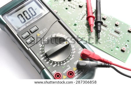 Digital multimeter with test electrodes - stock photo