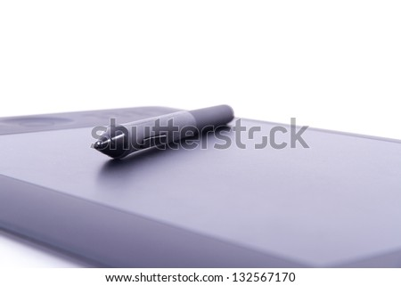 Digital pen on graphic tablet with depth of field, isolated on white background. - stock photo