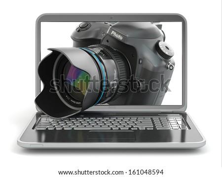 Digital photo camera and laptop. Journalist  or  traveler equipment. 3d - stock photo