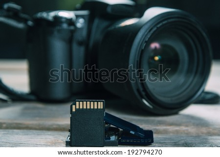Digital photo camera and memory cards, space for text - stock photo