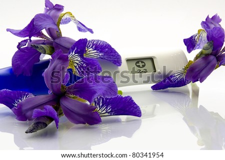Digital Pregnancy Test with flowers - stock photo