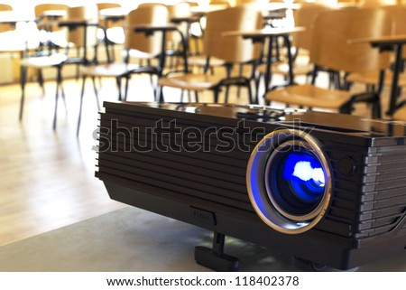 Digital projector in a conference hall - stock photo