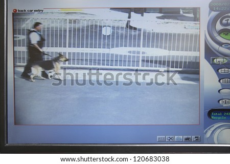 Digital screen showing picture of a cop walking with dog - stock photo