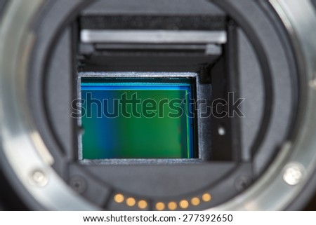Digital SLR Camera APS-C Sensor close-up - stock photo