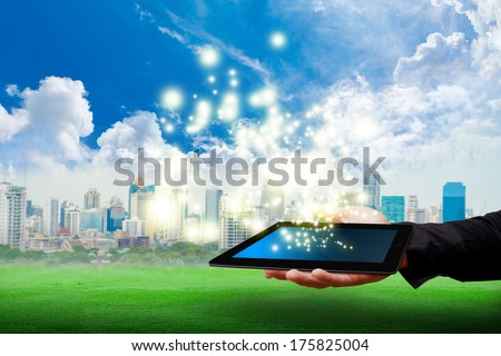 digital tablet and city background