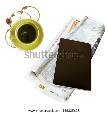 digital tablet and coffee cup on newspapers - stock photo