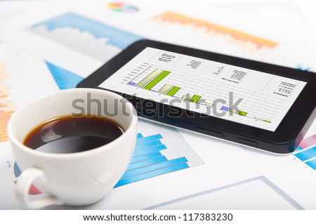 Digital tablet and financial data with modern - stock photo