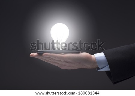 Digital Tablet and Glowing Light Bulb - stock photo