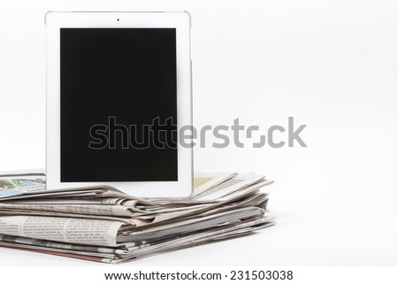 Digital tablet and newspapers, internet and electronic online news concept image  - stock photo