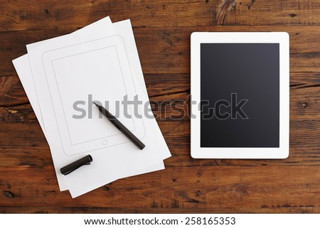 Digital Tablet and Note Paper on the Table