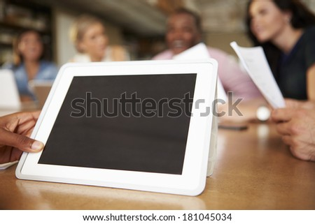 Digital Tablet Being Used By Architect In Meeting - stock photo