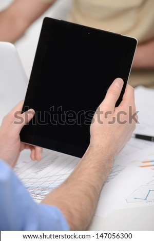 Digital tablet. Close-up of hands holding a digital tablet