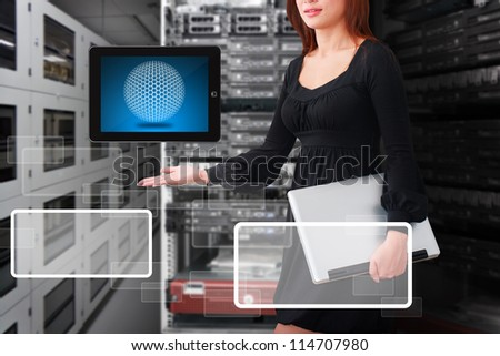 Digital tablet for control the sytem in data center room - stock photo