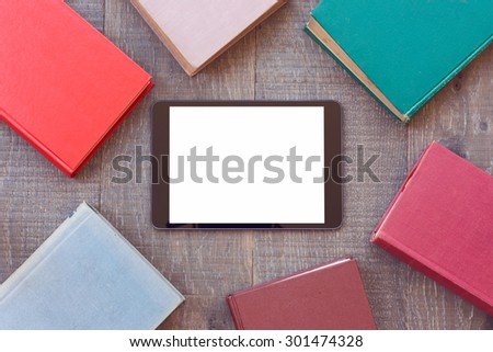 Digital tablet mock up template with books for e-book app presentation - stock photo