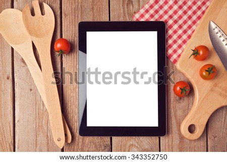 Digital tablet mock up template with cooking utensils and tomatoes. View from above - stock photo