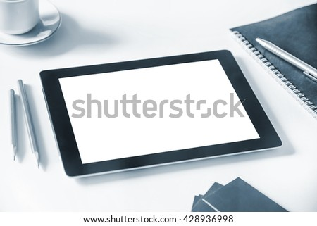 Digital tablet Mockup on table with white blank screen