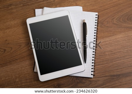 digital tablet on a wooden background - stock photo