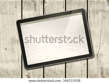 Digital tablet PC on a white wood table - horizontal office mockup - stock photo