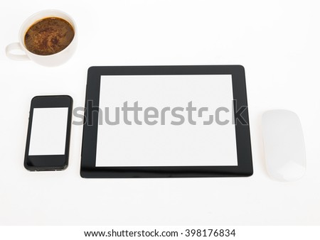 Digital tablet touch pad computer with coffee in office table business