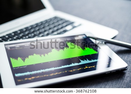Digital tablet with stock market graph - stock photo