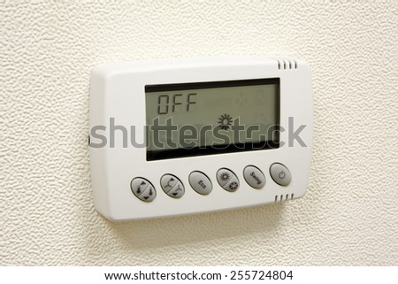 Digital thermostat - wall air condtitioning, temperature control - stock photo