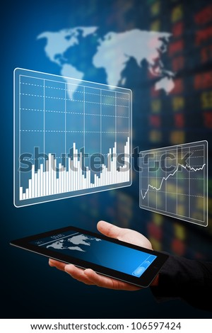 Digital touch pad and graph report - stock photo