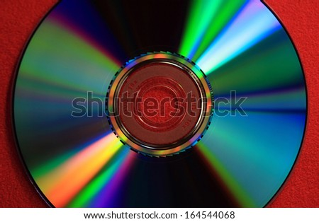 Digital Versatile Disk isolated on red background - stock photo