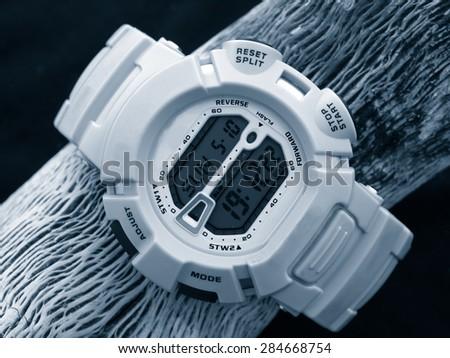 Digital watch chronograph monochrome - stock photo