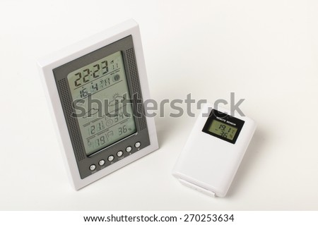 Digital weather station with wireless sensor isolated - stock photo