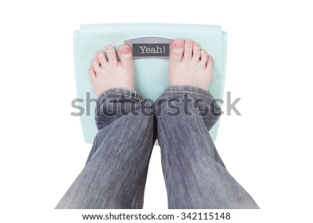 Digital weighing scales  Displaying YEAH! Message,the feet of a woman standing on Digital weighing scales  - stock photo