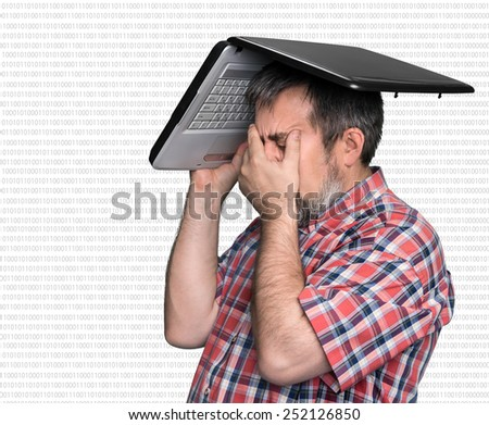 Digital world. Problems with computer. Middle aged stressed businessman with laptop on the head  - stock photo