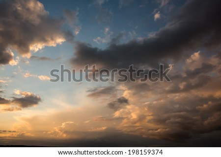 Digitally generated blue and orange sky with clouds