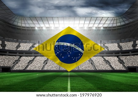 Digitally generated brazilian national flag against football stadium with fans in white