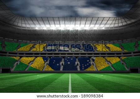 Digitally generated brazilian national flag against large football stadium - stock photo