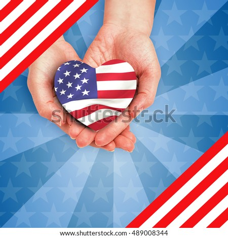 Digitally generated image of hands holding heart shape American flag