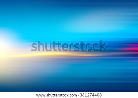 Digitally generated image of stripes  moving fast over blue background - stock photo