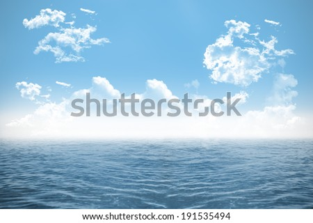 Digitally generated open sea under cloudy blue sky