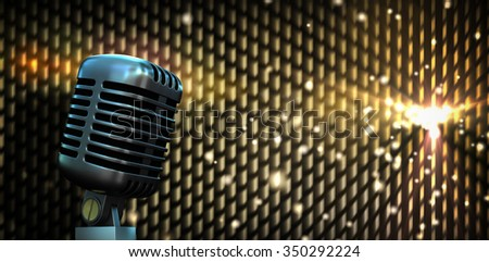 Digitally generated retro chrome microphone against digitally generated cool nightlife background