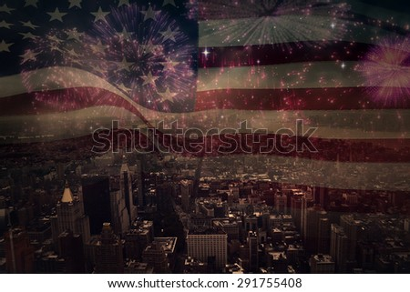 Digitally generated united states national flag against colourful fireworks exploding on black background