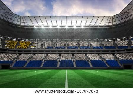 Digitally generated uruguay national flag against large football stadium - stock photo