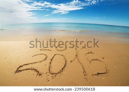 digits  2014 and 2015 on the seashore  sand - concept of new year and passing of time - stock photo