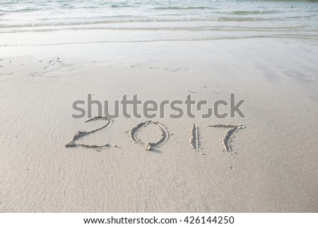 digits of the year on the sand - stock photo