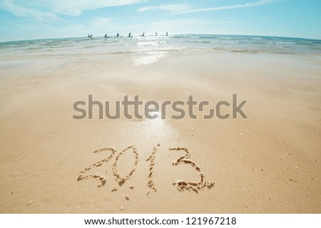 digits 2013 on the sand seashore - concept of new year - stock photo