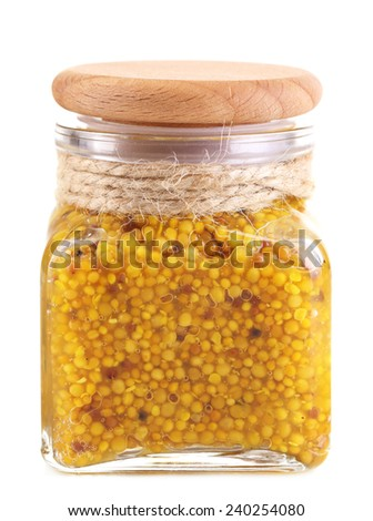 Dijon Mustard in glass jar isolated on white - stock photo