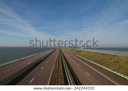 Dike men made over sea from one point of the Netherlands to another - stock photo