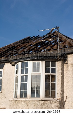 Dilapidated and burnt house - stock photo