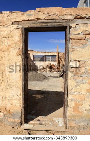 Dilapidated door frame at the Acoma Pueblo in New Mexico. - stock photo