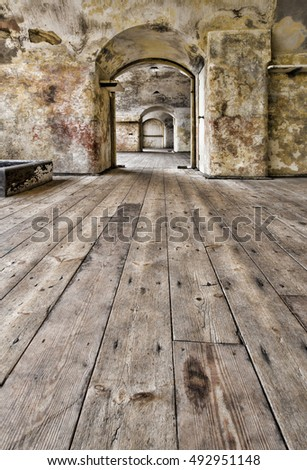 Dilapidated interior of historic English fort with worn wooden flooring