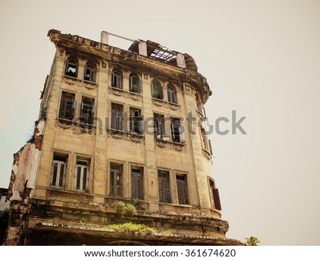 Dilapidated residential building, a vintage home - stock photo