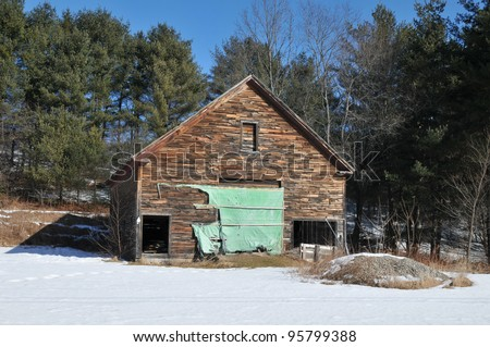 Dilapidated wooden barn near Newry, Maine that looks ready to fall down,